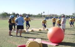 Season's Greetings: Varsity Football Team Says Hello to New District, New Teammates, and New Goal